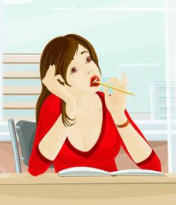 девочка пишет за столом и пытается перебороть себя